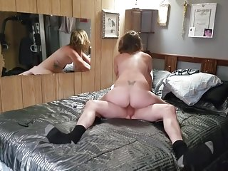 Gorgeous brunette milf rides his cock then gets creampied doggie style