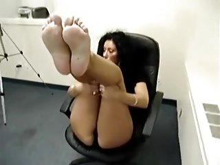 Sad face whore shows feet for money