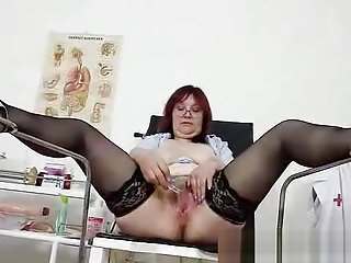 Redhead huge breasts mamma spreads her haired pussy