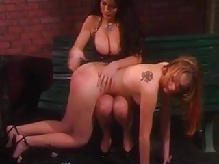 Brunette Mistress spanks her slaves ass