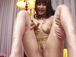 Misuzu Imai tastes her slit juice from finger